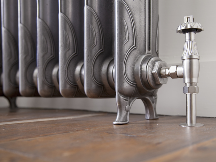 Liberty hand burnished cast iron radiator in detail with thermostatic valve